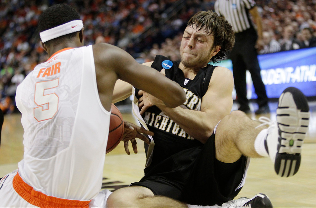 . Syracuse\'s C.J. Fair (5) and Western Michigan\'s Austin Richie (22) fight for control of the ball during the first half of a second-round game in the NCAA college basketball tournament in Buffalo, N.Y., Thursday, March 20, 2014. (AP Photo/Bill Wippert)