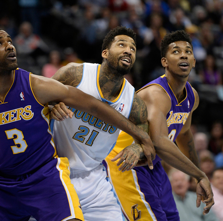 . DENVER, CO - NOVEMBER 13: Denver Nuggets small forward Wilson Chandler (21) fights for position with Los Angeles Lakers power forward Shawne Williams (3) and Los Angeles Lakers small forward Nick Young (0) during the first quarter November 13, 2013 at Pepsi Center. (Photo by John Leyba/The Denver Post)