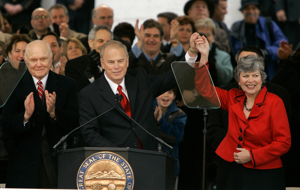 . Ohio\'s new Democratic Gov. Ted Strickland takes his wife Frances\'s hand Saturday, Jan. 13, 2007, at Ohio statehouse West Lawn in Columbus, Ohio during his public inauguration ceremony. At left is former Sen. John Glenn. (AP Photo/Kiichiro Sato)