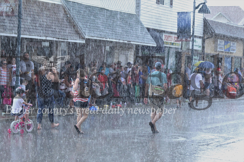 Mars residents didn't let a little rain cancel their Fourth of July fun. Kids chased free candy and splashed in puddle while parade participants proceeded through the rain. Seb Foltz/Butler Eagle
