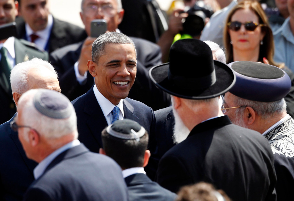 . U.S. President Barack Obama (C) speaks to Israel\'s Chief Rabbis Shlomo Amar (R) and Yona Metzger (2nd R) during an official welcoming ceremony at Ben Gurion International Airport near Tel Aviv March 20, 2013. REUTERS/Darren Whiteside