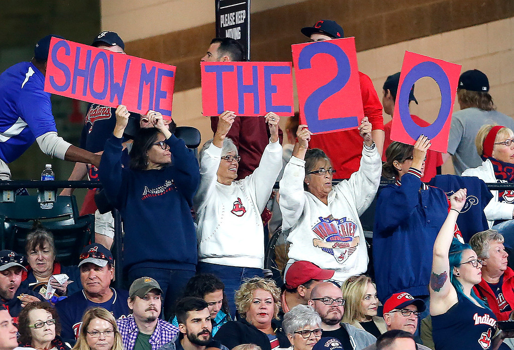 . Cleveland Indians fans cheer for their team to win their 20th straight game during the fourth inning in a baseball game against the Detroit Tigers, Tuesday, Sept. 12, 2017, in Cleveland. (AP Photo/Ron Schwane)