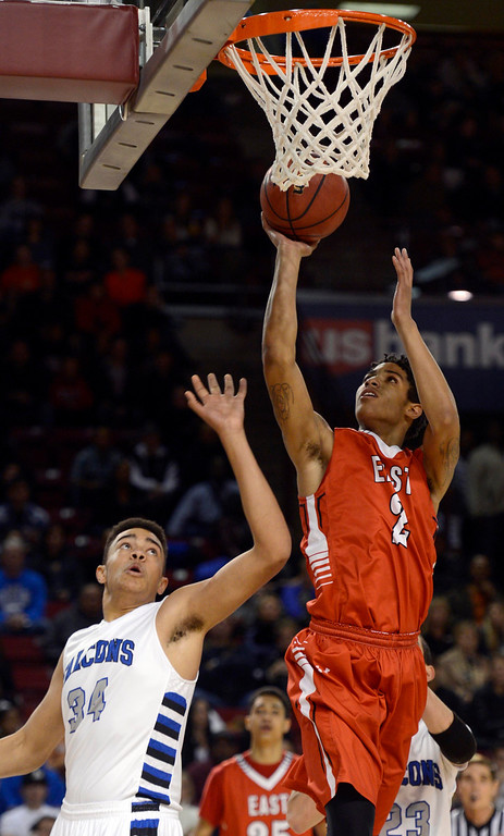 . DENVER, CO. - FEBRUARY 09: Jevon Griffin (2) of East goes up for a shot past Zach Braxton of  Highlands Ranch during the first quarter February 9, 2012 at Magness Arena. (Photo By John Leyba/The Denver Post)
