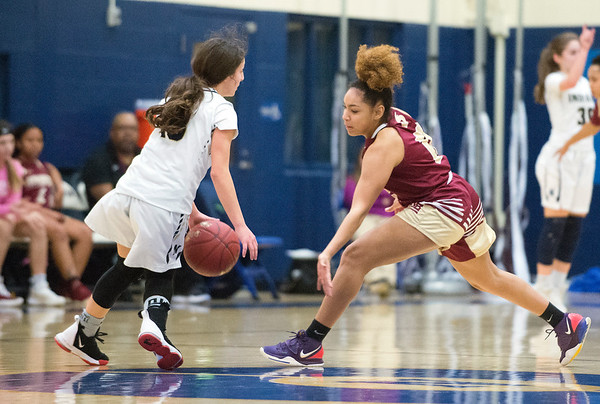 02/13/20 Wesley Bunnell | StaffrrNewington girls basketball defeated New Britain at home Thursday evening. Newington's Adriana Romano (13).