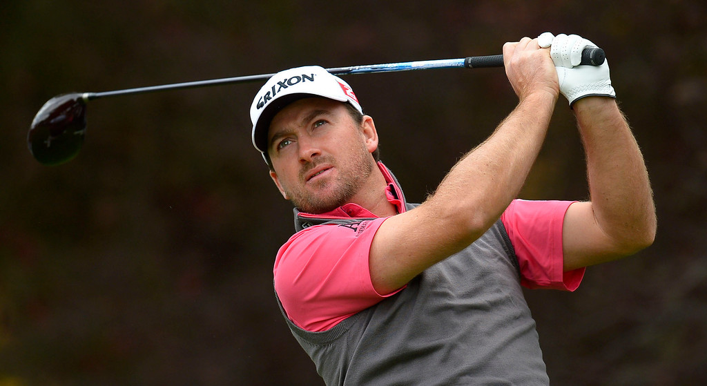. Graeme McDowell hits a tee shot on the second hole during the second round of the Northwestern Mutual World Challenge golf tournament at Sherwood Country Club, Friday, December 6, 2013, in Thousand Oaks, Calif. (Andy Holzman/Los Angeles Daily News)
