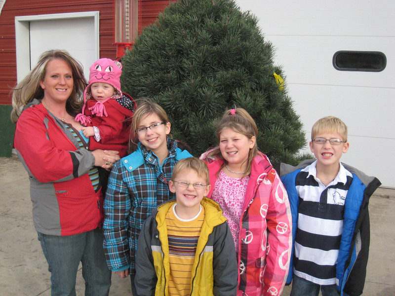 Michelle and family picked out their tree without Dave this year who is in Afghanistan but who got a real tree delivered to Afghanistan from Country Pines and their customers.