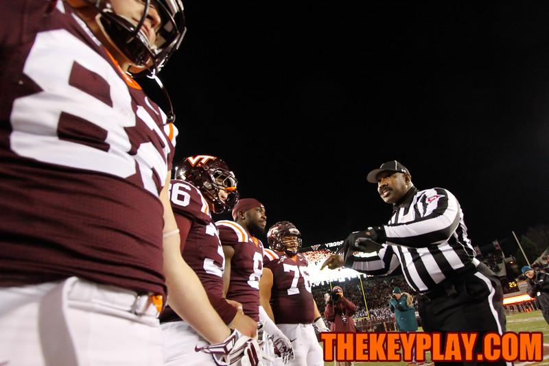 Umpire Terrence Ramsey tells the Virginia Tech captains to keep their players under control. (Mark Umansky/TheKeyPlay.com)