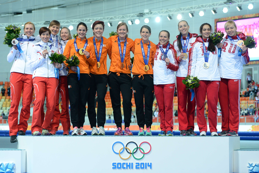 . Poland\'s silver medalist (L) Katarzyna Bachleda - Curus, Natalia Czerwonka, Katarzyna Wozniak and Luiza Zlotkowska, Netherlands\' gold medalists (C) Marrit Leenstra, Jorien ter Mors, Charlotte van Beek and Ireen Wust and Russia\'s bronze medalists (R) Olga Graf, Ekaterina Lobysheva, Ekaterina Shikhova and Yuliya Skokova pose during the Women\'s Speed Skating Team Pursuit Medal Ceremony at the Adler Arena during the Sochi Winter Olympics on February 22, 2014. (JUNG YEON-JE/AFP/Getty Images)