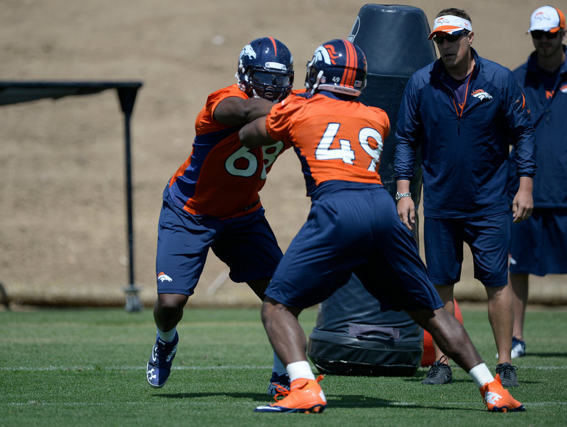 . Denver Broncos Kenny Anunike (68) runs through drills with Chase Vaughn (49) during OTAs June 12, 2014 at Dove Valley. (Photo by John Leyba/The Denver Post)