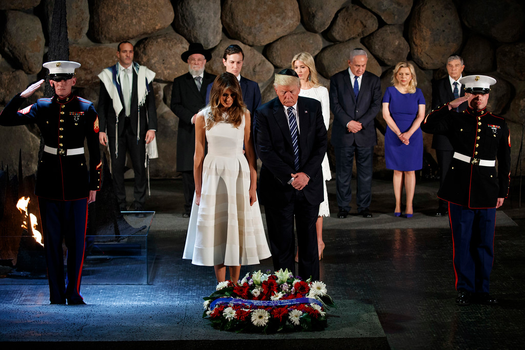 . FILE  - In this Tuesday, May 23, 2017 file photo, US President Donald Trump and first lady Melania Trump lay a wreath at Yad Vashem to honor the victims of the Holocaust, in Jerusalem. Trump wore a steady wardrobe of mostly black during President Donald Trump\'s overseas tour, including a prim black lace dress with a matching mantilla headcover that she wore to meet Pope Francis and a dark jacket with golden detailing on the cuff and collar that she wore for her arrival in Italy, both by Milan designers Domenico Dolce and Stefano Gabbana. (AP Photo/Evan Vucci, File)