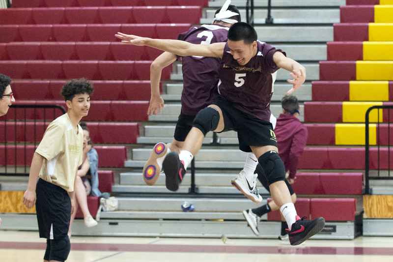 05/20/19  Wesley Bunnell | Staff  New Britain volleyball vs Simsbury on Monday night at New Britain High School.  Randy Slart (5) jumps in the air along with Giovany Hernandez (3) during introductions.