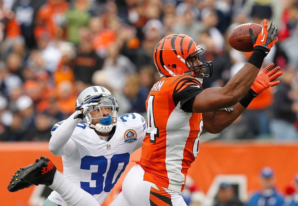 . Cincinnati Bengals tight end Jermaine Gresham makes the catch under pressure from the Dallas Cowboys\' Sterling Moore (30) defense during the first half of play in their NFL football game at Paul Brown Stadium in Cincinnati, Ohio, December 9, 2012.  REUTERS/John Sommers II