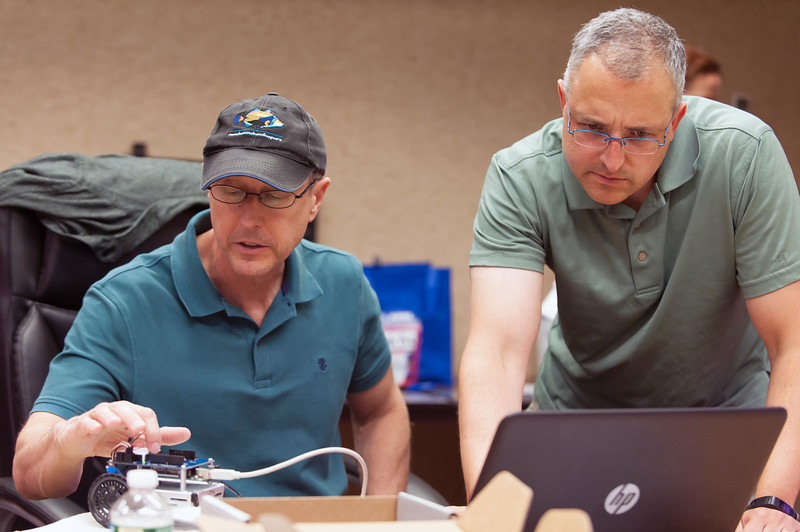 07/27/18  Wesley Bunnell | Staff  School teachers from across the country took part in a week long class assembling and operating robots at ARRL, the national association for Amateur Radio, in Newington from July 23rd through July 27th. The program was designed to help teachers incorporate electrical and wireless technology into their STEM curriculum. Jeff Weigel from Hampton Virginia looks over his robot as he works with Dan Pooler from Hudson New Hampshire.