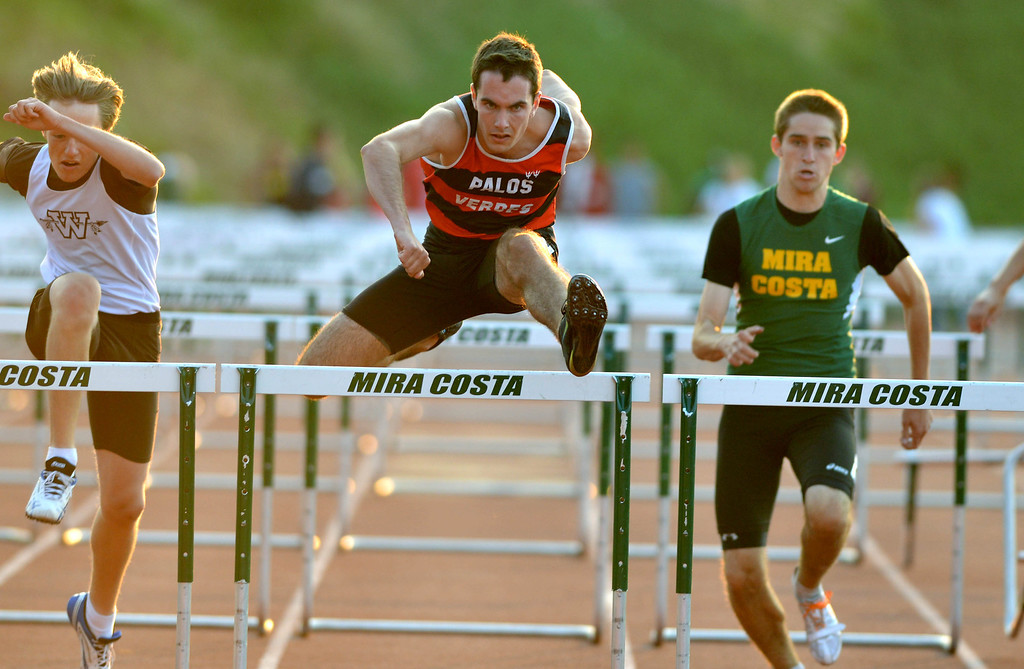 . 05-03-2013-(LANG Staff Photo by Sean Hiller)-  The Bay League track and field finals Friday night at Mira Costa High School. Brendan Weaver of Palos Verdes High wins the boys varsity 110 meter hurdles..