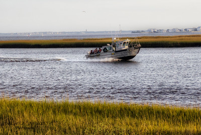 Fishing Boat - Cape Fear River; Bald Head Island Lighthouse in distance