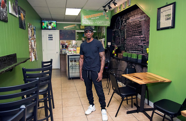 09/23/19 Wesley Bunnell | Staff Owner Mark Schand of Sweetwater Juice Bar & Deli at 60 W. Main St. stands inside of his business on Monday September 23, 2019. Schand spent 27 years in prison on a conviction which was later overturned.