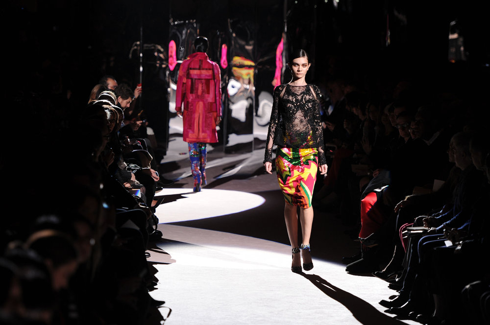 Description of . A model walks the runway at the Tom Ford show during London Fashion Week Fall/Winter 2013/14 at  on February 18, 2013 in London, England. (Photo by Eamonn McCormack/Getty Images)