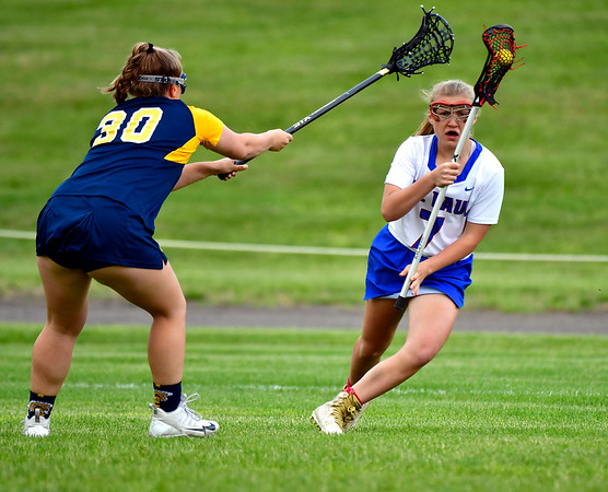 5/29/2019 Mike Orazzi | Staff St. Paul's Gabrielle Castonguay (7) and Weston's Mary Kohn (30) during Wednesday's Class S First Round lacrosse match in Bristol.