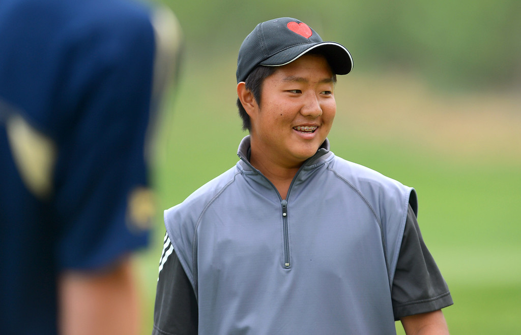 . Hart High School\'s Glen Lee lets out a smile after missing along putt while competing in the final round of the Foothill League Newhall Cup golf tournament at TPC Valencia April 24, 2013.(Andy Holzman/Staff Photographer)