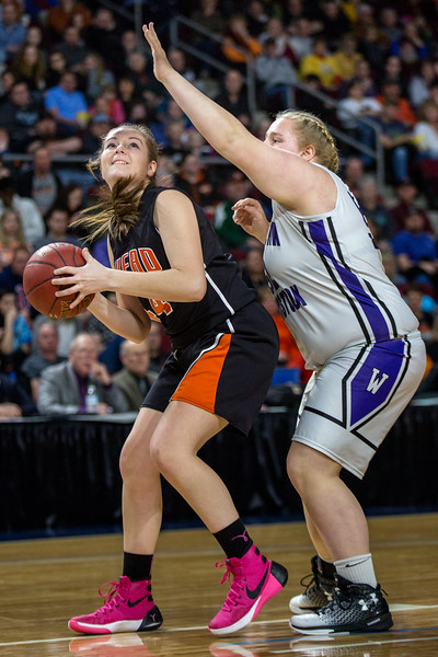 BANGOR, MAINE -- 0225/2017 -- Shead's Cassidy Wilder (left) looks for a shot as Southern Aroostook's Madison Cummings blocks during their class D girls championship game on Saturday morning at the Cross Insurance Center in Bangor. Micky Bedell | BDN