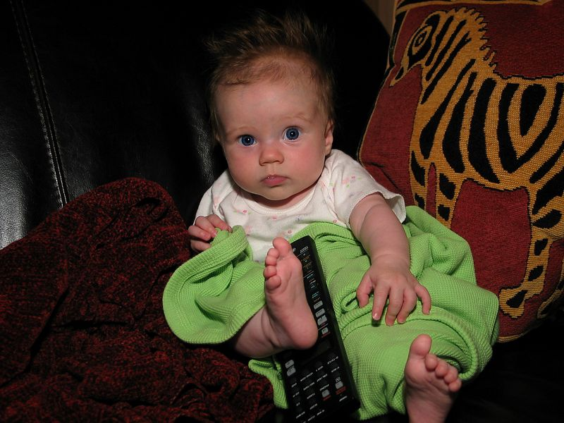 7/16 - Lili is kung-fu fighting for the remote :-)