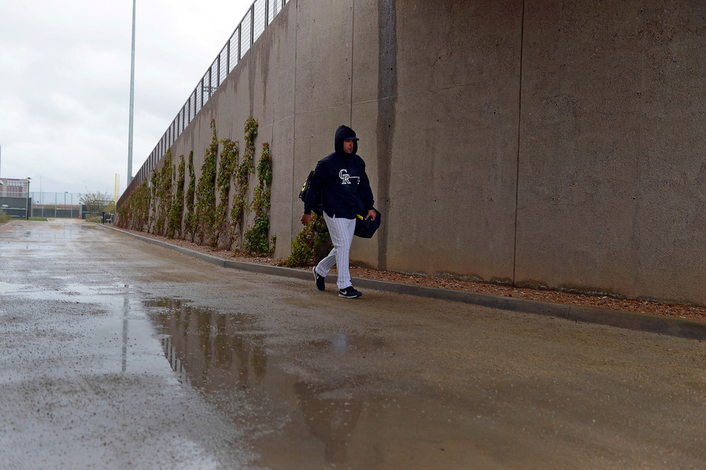 . SCOTTSDALE, AZ. - FEBRUARY 20: With the fields covered up, Colorado Rockies Yorvit Torrealba (8) heads to the cages due to rain during Spring Training February 20, 2013 in Scottsdale. (Photo By John Leyba/The Denver Post)
