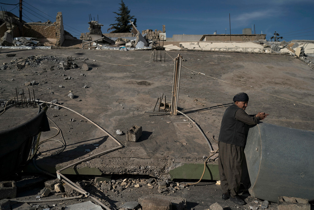. A man stands next to a destroyed house after an earthquake in the city of Darbandikhan, northern Iraq, Monday, Nov. 13, 2017. Authorities reported that a powerful 7.3 magnitude earthquake struck the Iraq-Iran border region on Monday and killed more than three hundred people in both countries, sent people fleeing their homes into the night and was felt far west as the Mediterranean coast. (AP Photo/Felipe Dana)