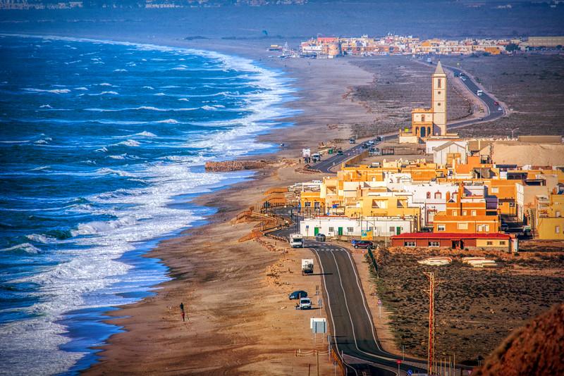 View of La Almadraba de Monteleva and San Miguel de Cabo de Gata (background), Gata Cape, Almeria, Andalusia, Spain