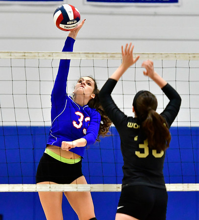 9/27/2018 Mike Orazzi | Staff St. Paul Volleyball's Kelsi Blatchley (33) and Woodland's Elayna Beutel (35) Thursday night in Bristol.