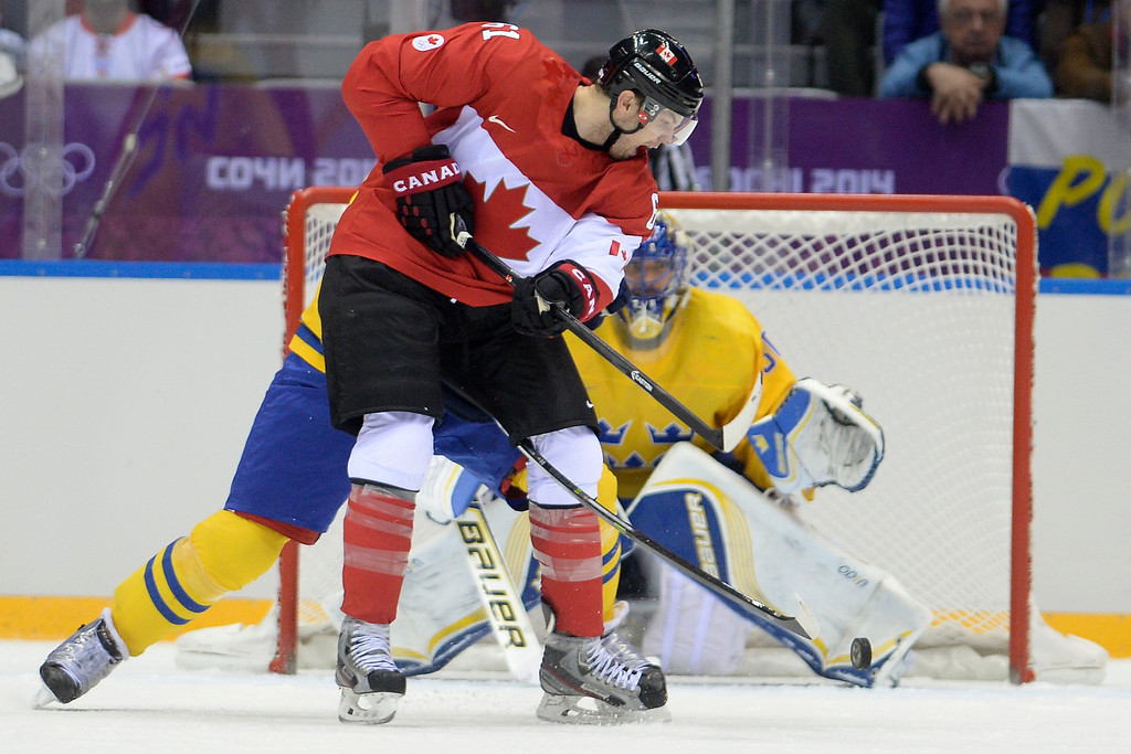 . Rick Nash (61) of Canada looks to take a shot on Henrik Lundqvist (30) of Sweden during the second period of the men\'s ice hockey gold medal game. Sochi 2014 Winter Olympics on Sunday, February 23, 2014 at Bolshoy Ice Arena. (Photo by AAron Ontiveroz/ The Denver Post)