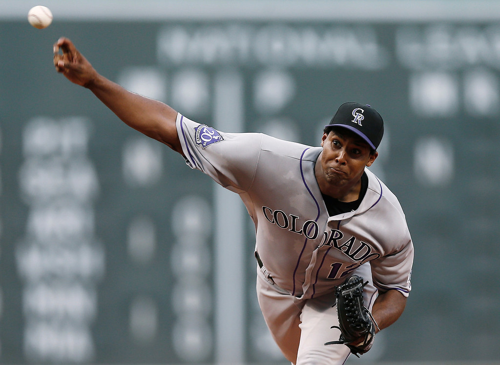 . Colorado Rockies starting pitcher Juan Nicasio delivers against the Boston Red Sox during the first inning of a baseball game at Fenway Park in Boston on Tuesday, June 25, 2013. (AP Photo/Winslow Townson)