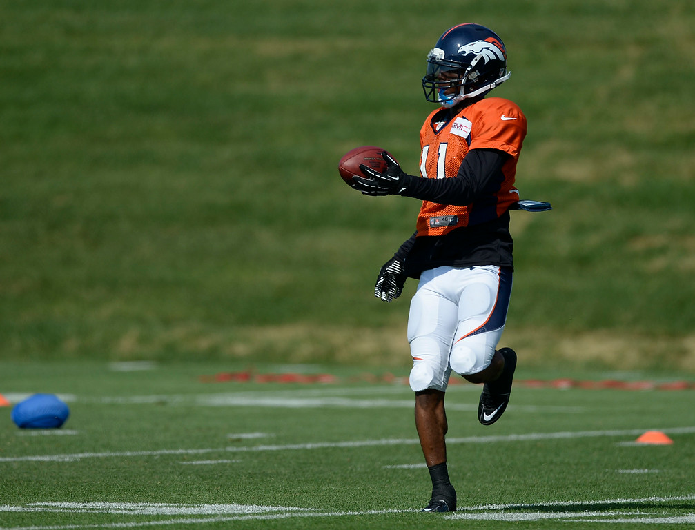 . Denver Broncos wide receiver Jordan Norwood (11) catches a pass during drills on day five of the Denver Broncos 2014 training camp July 28, 2014 at Dove Valley. (Photo by John Leyba/The Denver Post)