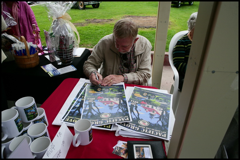 Barry signing posters at the show
