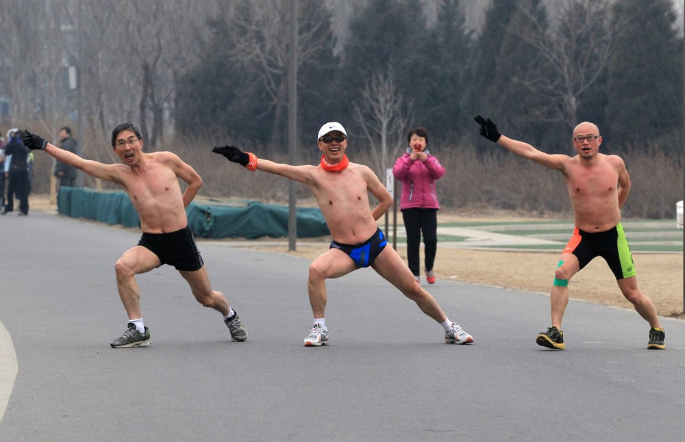 Description of . People take part in the Naked Running competition at Olympic Park on February 24, 2013 in Beijing, China. 300 participants took part in the annual 3.5 km Undie Run, which was held in Beijing's Olympic Forest Park on Sunday.  (Photo by ChinaFotoPress/ChinaFotoPress via Getty Images)