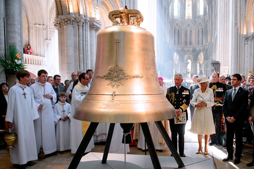 . Britain\'s Prince Charles, center and his wife Camilla, the Duchess of Cornwall, attend a bell-naming ceremony during a British D-Day commemoration ceremony in Bayeux Cathedral, northern France, Friday, June 6, 2014. World leaders and veterans gathered by the beaches of Normandy on Friday to mark the 70th anniversary of World War Two\'s D-Day landings. (AP Photo/Leon Neal, Pool
