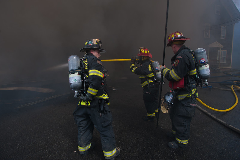 Hubbardston FFs play a Big Line into the remnants of a vacant factory on Sherman St.