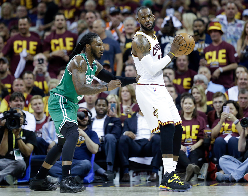. Cleveland Cavaliers\' LeBron James (23) backs down Boston Celtics\' Jae Crowder (99) during the first half of Game 3 of the NBA basketball Eastern Conference finals, Sunday, May 21, 2017, in Cleveland. (AP Photo/Tony Dejak)