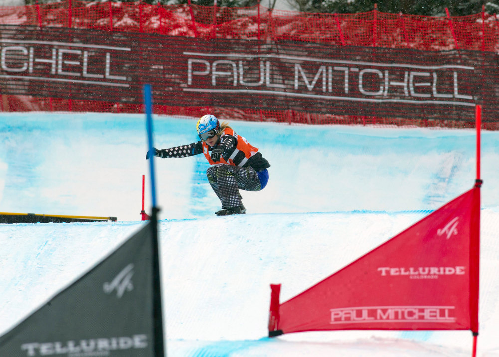 . In this photo provided by Nathan Bilow Photography, Canada\'s Dominique Maltais leads her heat in the women\'s snowboard cross World Cup team event in Telluride, Colo., Saturday, Dec. 15, 2012. Maltais and teammate Maelle Ricker placed first in Saturday\'s race. (AP Photo/Nathan Bilow)