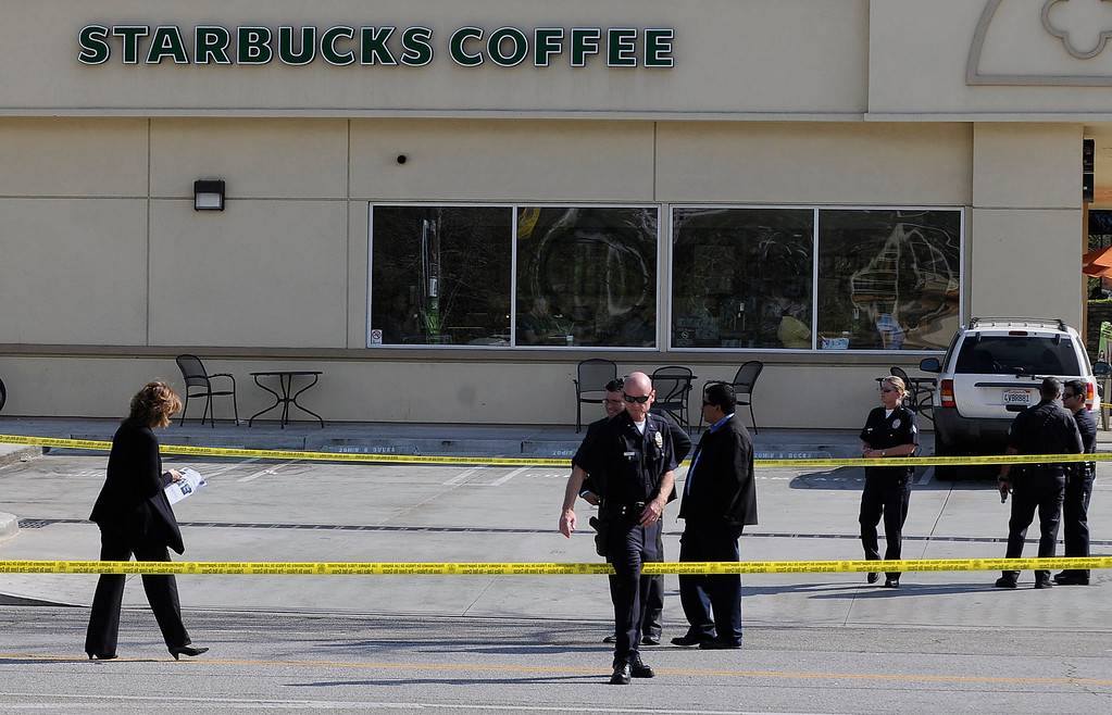 . Police officers gather around the Starbucks Coffee located at the intersection of Canoga and Oxnard in Woodland Hills. A 10-year-old girl who was reported missing from her family\'s Northridge home was found safe Monday afternoon in Woodland Hills, and police said it was unclear whether she had been abducted or ran away. After an 11-hour search, Nicole Ryan was found near a strip mall about six miles from her home, Los Angeles police Capt. Kris Pitcher said. Woodland Hills,CA 3/26/2013(John McCoy/Staff Photographer