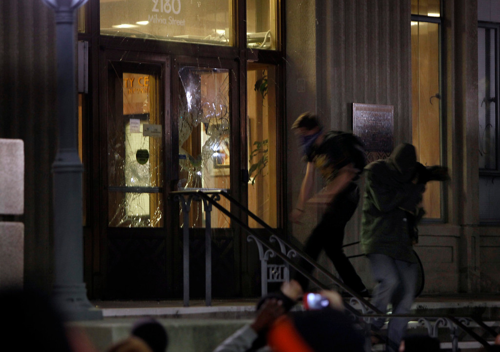 . The front doors of the Martin Luther King, Jr. Civic Center building are broken by protesters in Berkeley, Calif., late Sunday evening, Dec. 7, 2014, during a second consecutive night of unrest in the city over the killings of two unarmed black men by police in Ferguson, Mo., and New York. (Karl Mondon/Bay Area News Group)