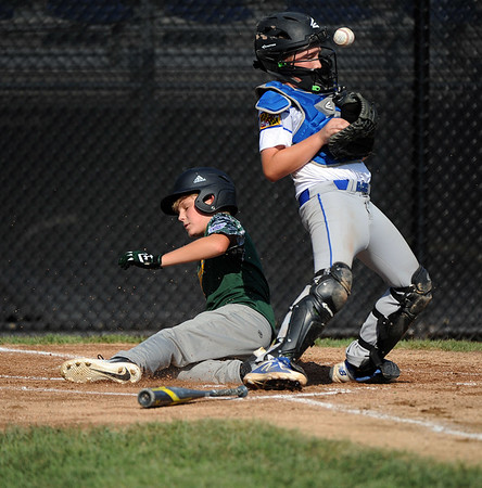 8/6/2018 Mike Orazzi   Staff Middletown New Jersey Little League's James Finer (10) scores as Maryland's Ryder Swanson (37) takes the throw at Breen Field in Bristol during the 2018 Little League Eastern Regional Tournament.