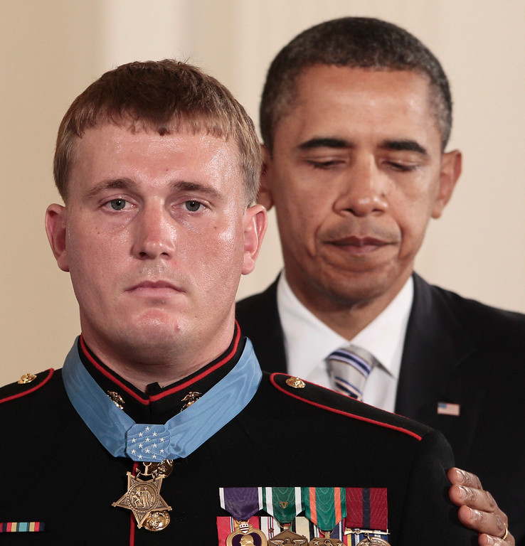 . President Barack Obama awards the Medal of Honor to former Marine Corps Cpl. Dakota Meyer, 23, from Greensburg, Ky., Thursday, Sept. 15, 2011, during a ceremony in the East Room of the White House in Washington. Meyer was in Afghanistan\'s Kunar province in Sept. 2009 when he repeatedly ran through enemy fire to recover the bodies of fellow American troops. He is the first living Marine to be awarded the Medal of Honor for actions in Iraq or Afghanistan. (AP Photo/Pablo Martinez Monsivais)