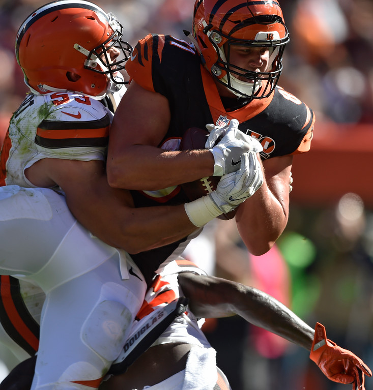 . Cincinnati Bengals tight end Tyler Kroft (81) is tackled by Cleveland Browns outside linebacker Joe Schobert (53) for a 16-yard touchdown in the second half of an NFL football game, Sunday, Oct. 1, 2017, in Cleveland. (AP Photo/David Richard)