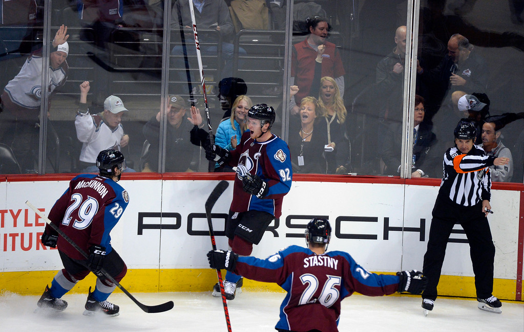 . Colorado Avalanche left wing Gabriel Landeskog (92) celebrates his goal with Colorado Avalanche center Nathan MacKinnon (29) during the seoncd period to tie the game at 2-2 October 17, 2013 at Pepsi Center.(Photo by John Leyba/The Denver Post)