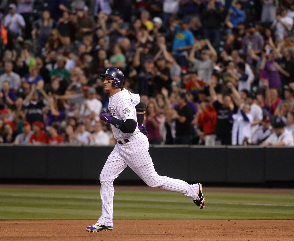 . DENVER, CO - APRIL 18: Colorado\'s Troy Tulowitzki rounded the bases on his second inning home run. The Colorado Rockies hosted the Philadelphia Phillies Friday night, April 18, 2014 at Coors Field.  (Photo by Karl Gehring/The Denver Post)