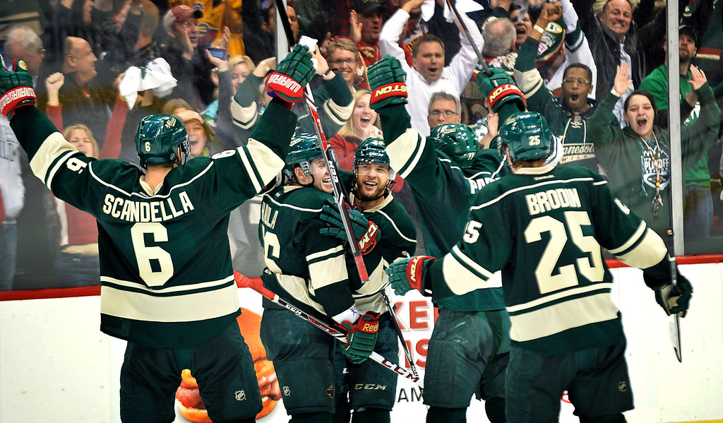 . Minnesota Wild right wing Jason Pominville is congratulated after scoring an empty-net goal during the third period. (Pioneer Press: Ben Garvin)