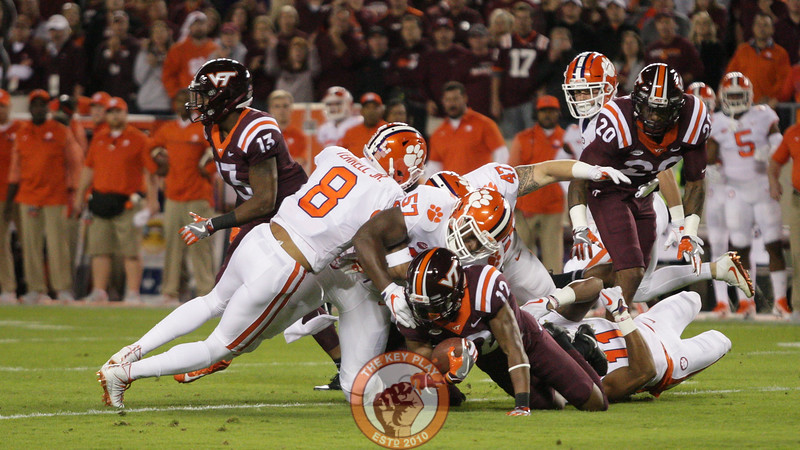 WR Henri Murphy gets tackled by a group of Clemson defenders after a short pass. (Mark Umansky/TheKeyPlay.com)