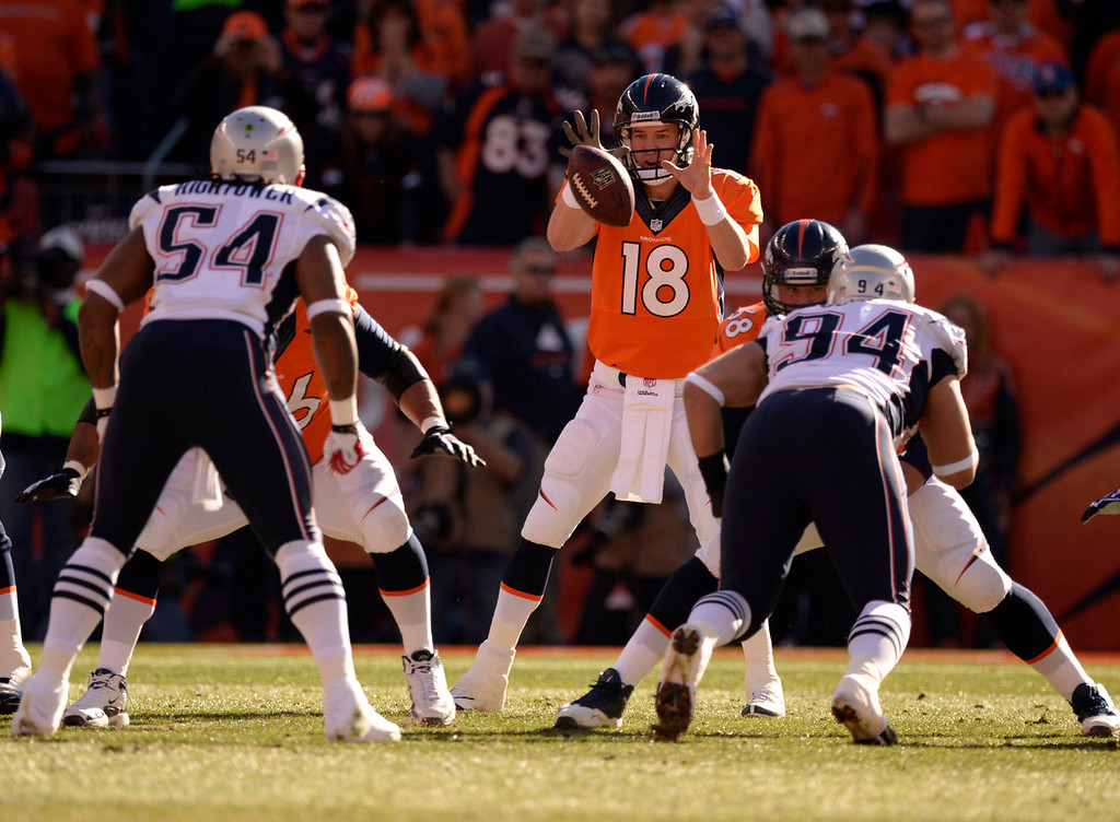 . Denver Broncos quarterback Peyton Manning (18) waits for the ball during the first quarter. The Denver Broncos vs. The New England Patriots in an AFC Championship game  at Sports Authority Field at Mile High in Denver on January 19, 2014. (Photo by John Leyba/The Denver Post)