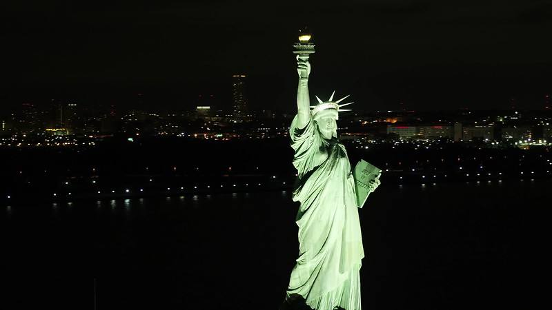 Drone Statue of LIberty New York in background 4k 24p