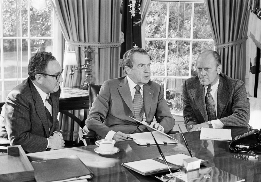 . In this Oct. 13, 1973 file photo, then-vice presidential nominee Gerald R. Ford, right, listens as President Richard Nixon, accompanied by Secretary of State Henry Kissinger, speaks in the Oval Office of the White House in Washington. Overseas reaction to Nixon�s resignation in 1974 was mixed: The Soviets expressed worry about the future of detente. North Korea reacted brashly, calling Nixon�s exit the �falling out� of the �wicked boss� of American imperialists. South Vietnam put its forces on high alert because it feared the North Vietnamese would take advantage of the vulnerable U.S. political situation.  (AP Photo/Harvey W. Georges, File)